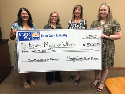 Left to right: Denise Duerksen, HCUW Community Investment Chair, Tamie Larez, Newton Meals on Wheels, Danielle Randall, HCUW Board Member, and Hannah Hahn, HCUW Board Chair